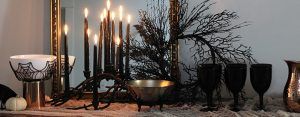 black candle and decorations