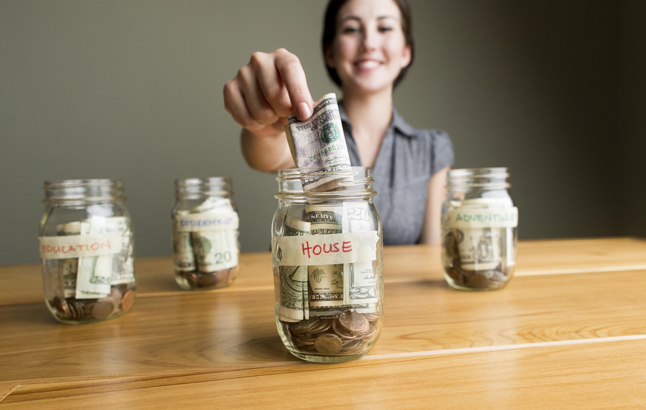 woman saving on a jar