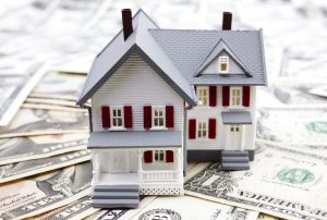 a house model and money