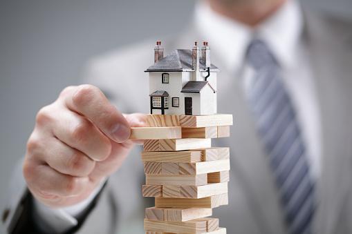 a house model on top of a jinga