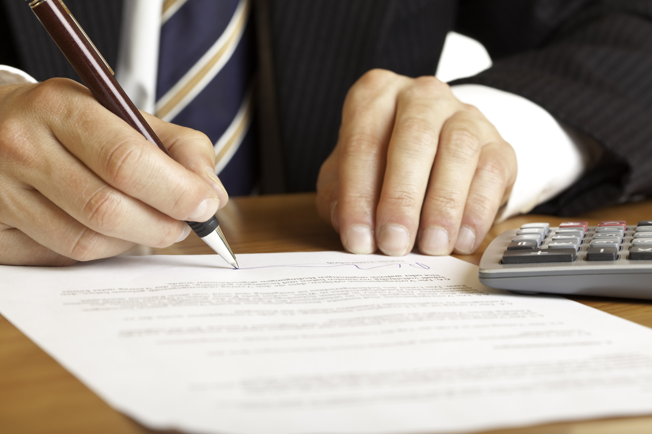 a hands signing a contract