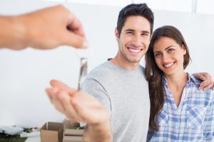 a happy couple being given a house key