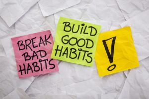 a break bad habits written on a adhesive notes